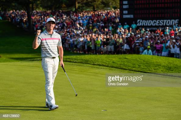 Rory McIlroy of Northern Ireland celebrates his two stroke victory against Sergio Garcia of Spain on the 18th hole green during the final round of...