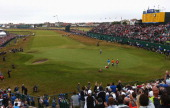 Rory McIlroy of Northern Ireland celebrates his twostroke victory on the 18th green during the final round of The 143rd Open Championship at Royal...