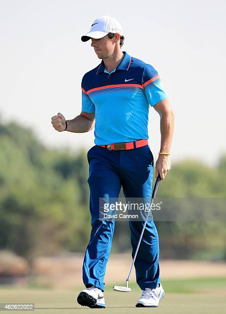 Rory McIlroy of Northern Ireland celebrates holing a tricky par putt on the par 4 12th hole during the final round of the 2015 Omega Dubai Desert...