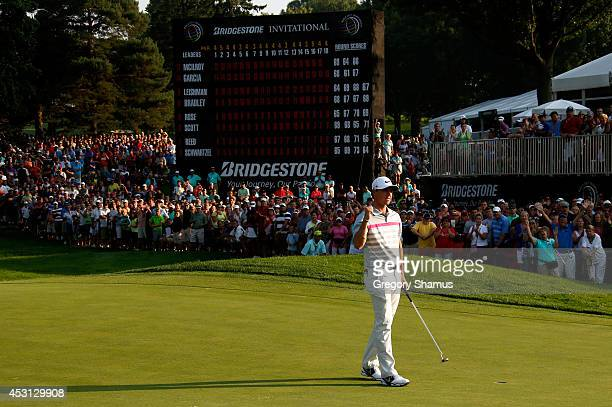Rory McIlroy of Northern Ireland celebrates on the 18th green after winning the World Golf ChampionshipsBridgestone Invitational during the final...
