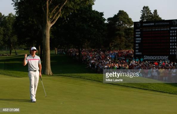 Rory McIlroy of Northern Ireland celebrates on the 18th green after winning the World Golf ChampionshipsBridgestone Invitational during the final...