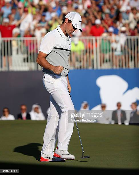 Rory McIlroy of Northern Ireland celebrates on the 18th green after winning the Race To Dubai and DP World Tour Championship during the final round...