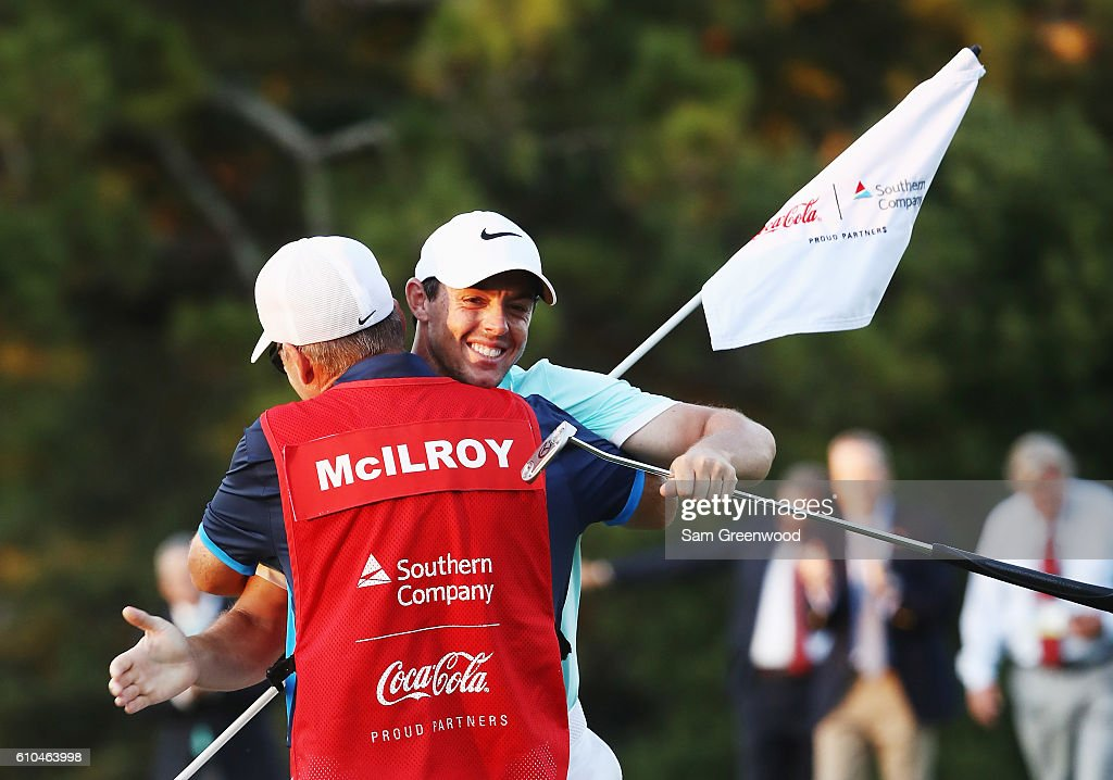Rory McIlroy of Northern Ireland celebrates with his caddie J.P. Fitzgerald after holing a birdie putt to defeat Ryan Moore on the fourth playoff hole to win the TOUR Championship and clinch the FedExCup at East Lake Golf Club on September 25, 2016 in Atlanta, Georgia.