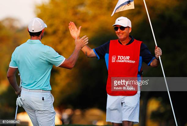 Rory McIlroy of Northern Ireland celebrates with his caddie JP Fitzgerald after holing a birdie putt to defeat Ryan Moore on the fourth playoff hole...