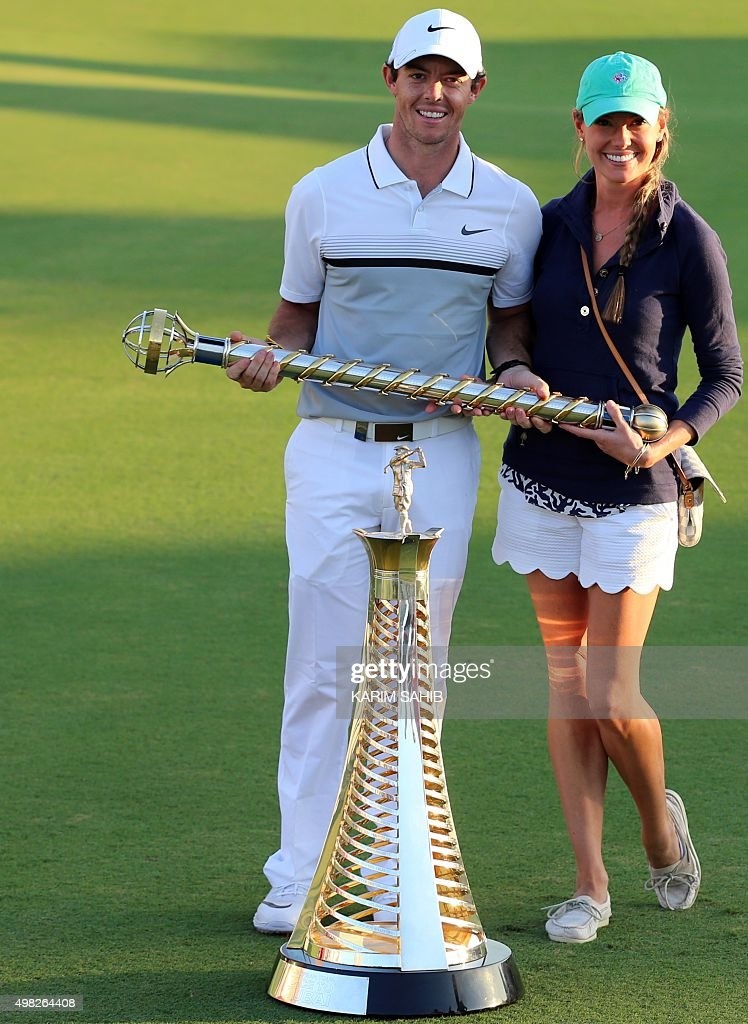 Rory McIlroy of Northern Ireland celebrates with his girlfriend Erica Stoll after winning the the DP World Tour Golf Championship in Dubai, on November 22, 2015. The $8 million DP World Tour Championship features the top-60 players in the Race to Dubai.