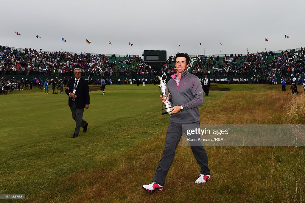 Rory McIlroy of Northern Ireland celebrates with the Claret Jug after his two-stroke victory on the 18th green during the final round of The 143rd Open Championship at Royal Liverpool on July 20, 2014 in Hoylake, England.