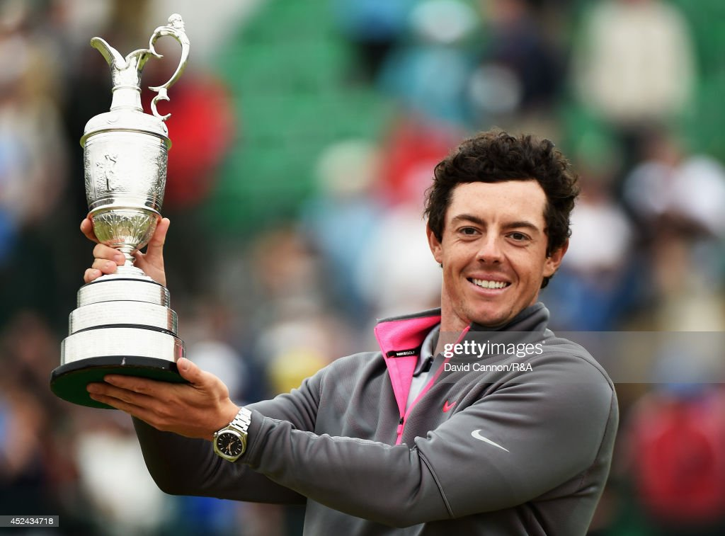 <a gi-track='captionPersonalityLinkClicked' href=/galleries/search?phrase=Rory+McIlroy&family=editorial&specificpeople=783109 ng-click='$event.stopPropagation()'>Rory McIlroy</a> of Northern Ireland celebrates with the Claret Jug after his two-stroke victory after the final round of The 143rd Open Championship at Royal Liverpool on July 20, 2014 in Hoylake, England.