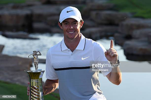 Rory McIlroy of Northern Ireland celebrates with the Race to Dubai Trophy after the final round of the DP World Tour Championship on the Earth Course...