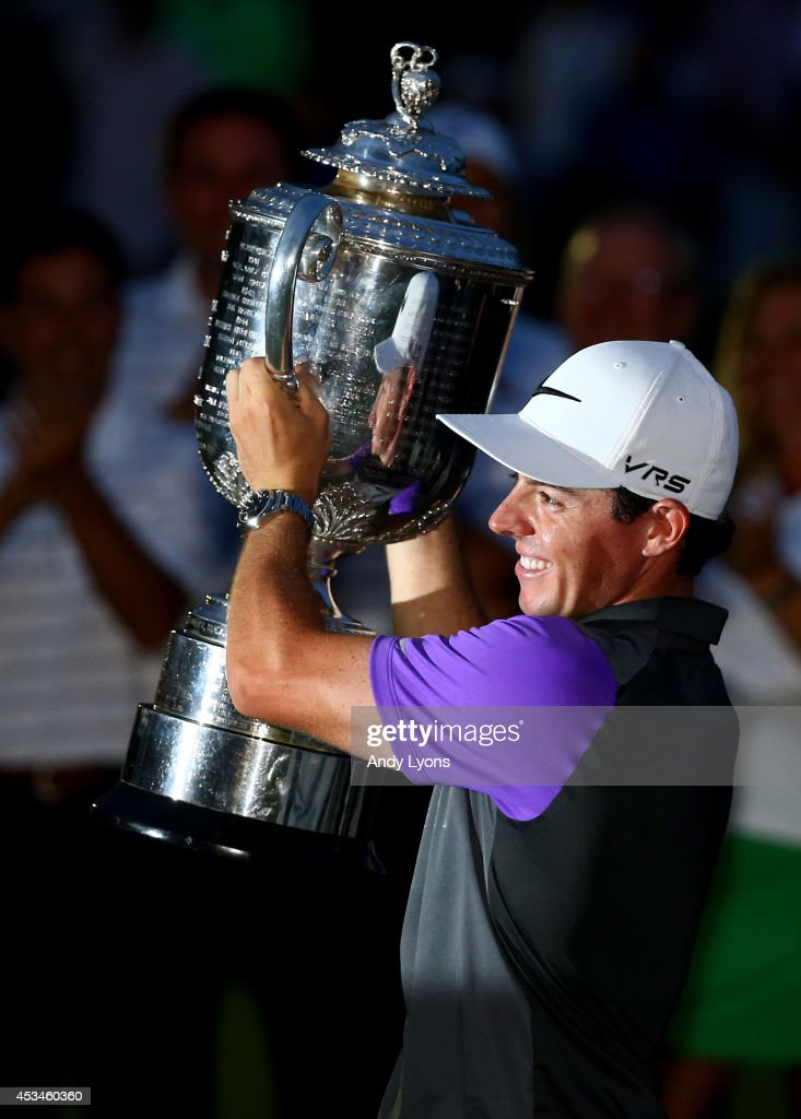 <a gi-track='captionPersonalityLinkClicked' href=/galleries/search?phrase=Rory+McIlroy&family=editorial&specificpeople=783109 ng-click='$event.stopPropagation()'>Rory McIlroy</a> of Northern Ireland celebrates with the Wanamaker trophy after his one-stroke victory during the final round of the 96th PGA Championship at Valhalla Golf Club on August 10, 2014 in Louisville, Kentucky.