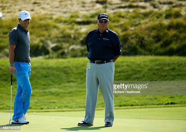 Rory McIlroy of Northern Ireland chats with Butch Harmon during a practice round prior to the 2015 PGA Championship at Whistling Straits on August 12...