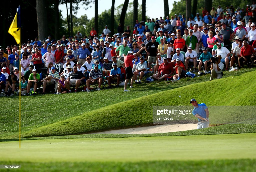 <a gi-track='captionPersonalityLinkClicked' href=/galleries/search?phrase=Rory+McIlroy&family=editorial&specificpeople=783109 ng-click='$event.stopPropagation()'>Rory McIlroy</a> of Northern Ireland chips from a bunker to the 14th green during the third round of the 96th PGA Championship at Valhalla Golf Club on August 9, 2014 in Louisville, Kentucky.