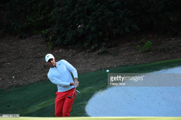 Rory McIlroy of Northern Ireland chips to the 13th green during the third round of the 2017 Masters Tournament at Augusta National Golf Club on April...