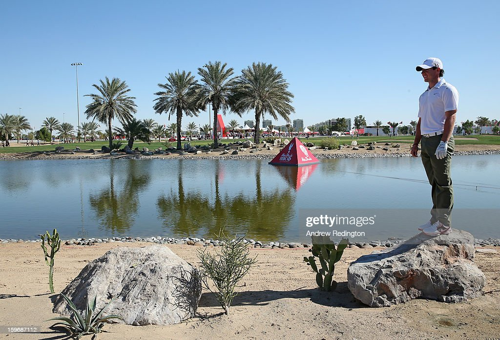 Rory McIlroy of Northern Ireland climbs on a rock to gain better vantage point on the 9th hole during the second round of The Abu Dhabi HSBC Golf Championship at Abu Dhabi Golf Club on January 18, 2013 in Abu Dhabi, United Arab Emirates.