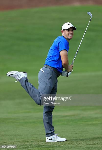 Rory McIlroy of Northern Ireland follows his second shot on the par 5 seventh hole during the final round of the DP World Tour Championship on the...