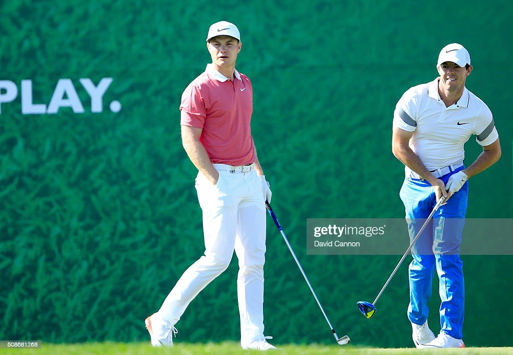<a gi-track='captionPersonalityLinkClicked' href=/galleries/search?phrase=Rory+McIlroy&family=editorial&specificpeople=783109 ng-click='$event.stopPropagation()'>Rory McIlroy</a> of Northern Ireland (r) follows his tee shot at the par 4, second hole as his playing partner <a gi-track='captionPersonalityLinkClicked' href=/galleries/search?phrase=Oliver+Fisher&family=editorial&specificpeople=227218 ng-click='$event.stopPropagation()'>Oliver Fisher</a> of England moves onto the tee to play his shot during the third round of the 2016 Omega Dubai Desert Classic on the Majlis Course at the Emirates Golf Club on February 6, 2016 in Dubai, United Arab Emirates.