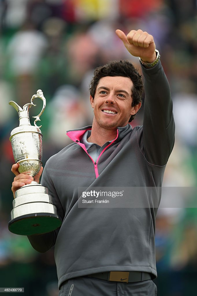 Rory McIlroy of Northern Ireland gives a thumbs up as he holds the Claret Jug after his two-stroke victory at The 143rd Open Championship at Royal Liverpool on July 20, 2014 in Hoylake, England.