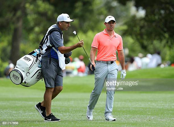 Rory McIlroy of Northern Ireland hands his club to his caddy JP Fitzgerald during day four of the BMW South African Open Championship at Glendower...
