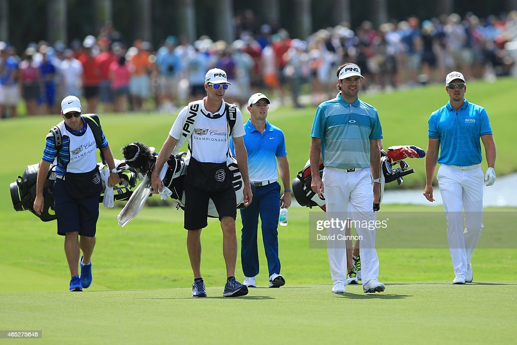 Rory McIlroy of Northern Ireland Henrik Stenson of Sweden and Bubba Watson of the United States walk on the tenth hole during the first round of the...