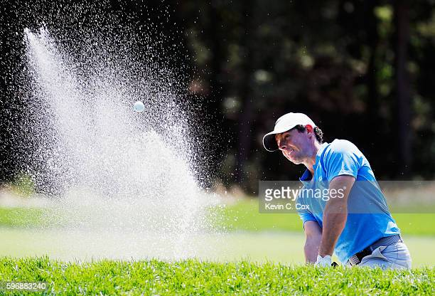 Rory McIlroy of Northern Ireland hits a bunker shot on the fourth hole during the final round of The Barclays in the PGA Tour FedExCup PlayOffs on...