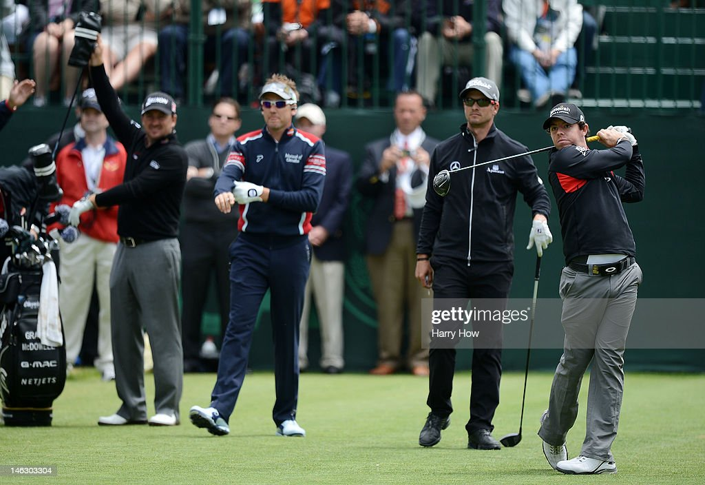 Rory McIlroy of Northern Ireland hits a shot as Graeme McDowell of Northern Ireland, Ian Poulter of England and Adam Scott of Australia look on during a practice round prior to the start of the 112th U.S. Open at The Olympic Club on June 13, 2012 in San Francisco, California.