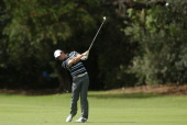 Rory McIlroy of Northern Ireland hits a shot during a practice round ahead of the 2013 Australian Open at Royal Sydney Golf Club on November 26 2013...