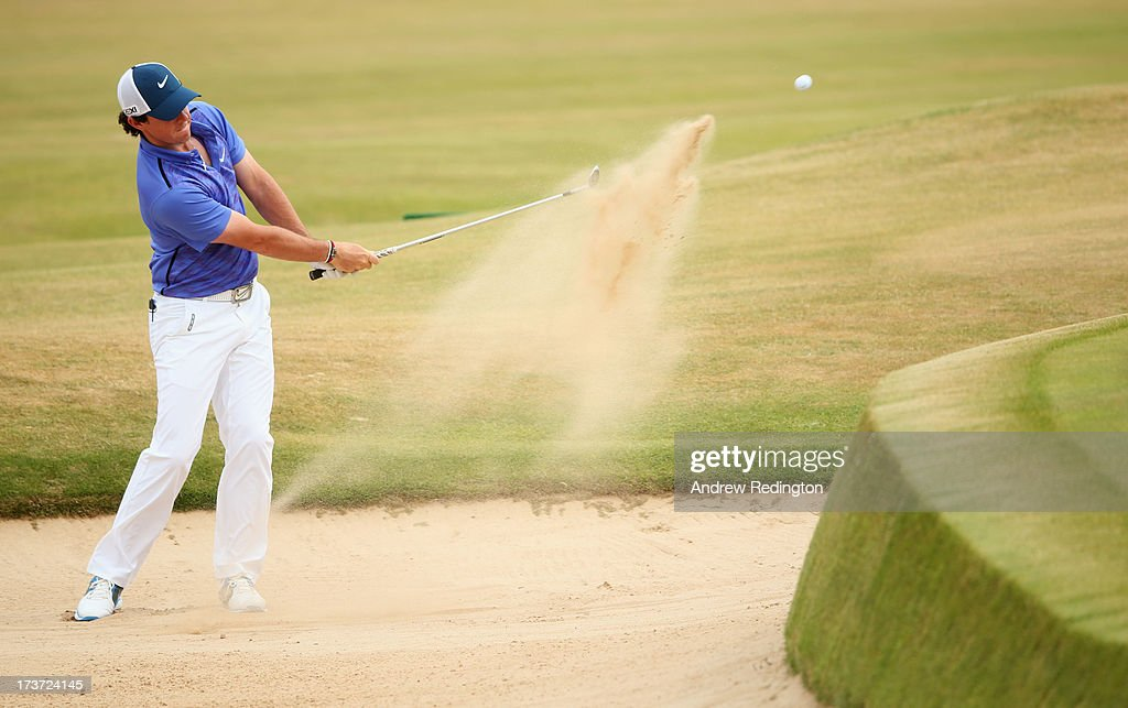 Rory McIlroy of Northern Ireland hits a shot from a bunker ahead of the 142nd Open Championship at Muirfield on July 17, 2013 in Gullane, Scotland.