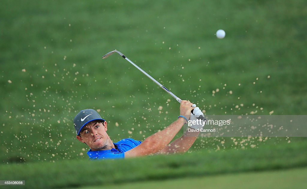 <a gi-track='captionPersonalityLinkClicked' href=/galleries/search?phrase=Rory+McIlroy&family=editorial&specificpeople=783109 ng-click='$event.stopPropagation()'>Rory McIlroy</a> of Northern Ireland hits a shot from a greenside bunker on the 18th hole during the third round of the 96th PGA Championship at Valhalla Golf Club on August 9, 2014 in Louisville, Kentucky.