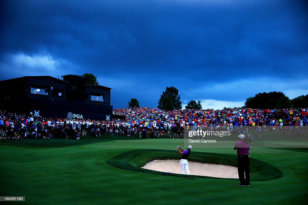<a gi-track='captionPersonalityLinkClicked' href=/galleries/search?phrase=Rory+McIlroy&family=editorial&specificpeople=783109 ng-click='$event.stopPropagation()'>Rory McIlroy</a> of Northern Ireland hits a shot from a greenside bunker on the 18th hole during the final round of the 96th PGA Championship at Valhalla Golf Club on August 10, 2014 in Louisville, Kentucky.