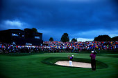 Rory McIlroy of Northern Ireland hits a shot from a greenside bunker on the 18th hole during the final round of the 96th PGA Championship at Valhalla...