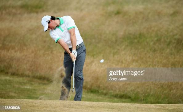 Rory McIlroy of Northern Ireland hits a shot from the 6th during the first round of the 142nd Open Championship at Muirfield on July 18 2013 in...