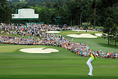 Rory McIlroy of Northern Ireland hits a shot from the rough on the second hole during the final round of the 2015 Masters Tournament at Augusta...