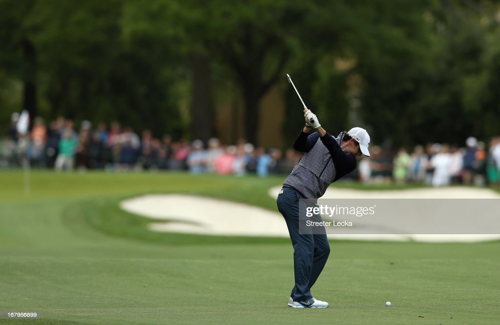 Rory McIlroy of Northern Ireland hits a shot on the 4th hole during the second round of the Wells Fargo Championship at Quail Hollow Club on May 3, 2013 in Charlotte, North Carolina.