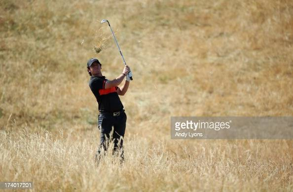 Rory McIlroy of Northern Ireland hits a shot on the 6th hole during the second round of the 142nd Open Championship at Muirfield on July 19 2013 in...