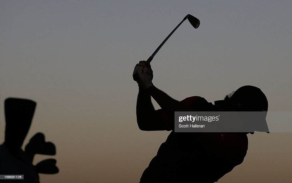 Rory McIlroy of Northern Ireland hits a shot on the practice ground before the start of the first round of the Abu Dhabi HSBC Golf Championship at Abu Dhabi Golf Club on January 17, 2013 in Abu Dhabi, United Arab Emirates.