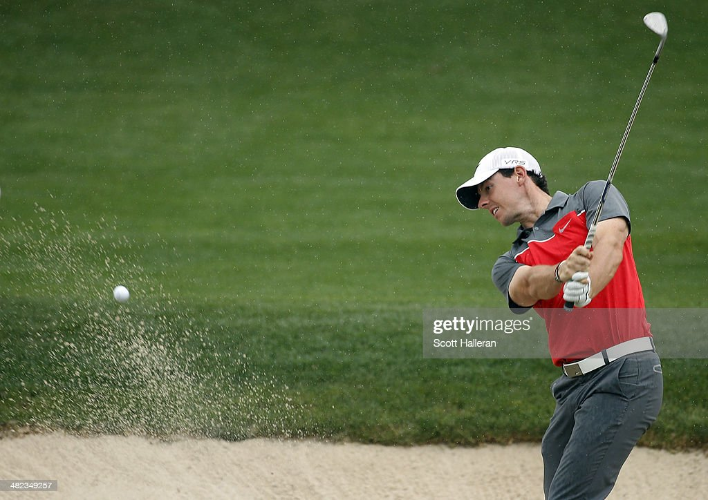 Rory McIlroy of Northern Ireland hits a shot out of the bunker on the eighth hole during round one of the Shell Houston Open at the Golf Club of Houston on April 3, 2014 in Humble, Texas.