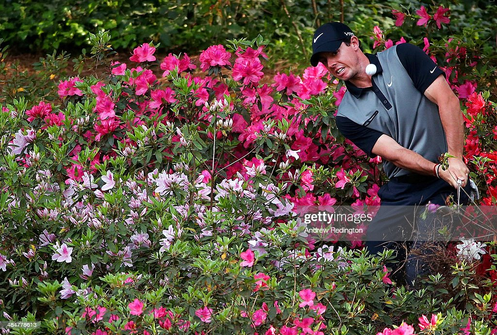 Rory McIlroy of Northern Ireland hits a shot out of the the azalea bushes behind the 13th green during the second round of the 2014 Masters Tournament at Augusta National Golf Club on April 11, 2014 in Augusta, Georgia.