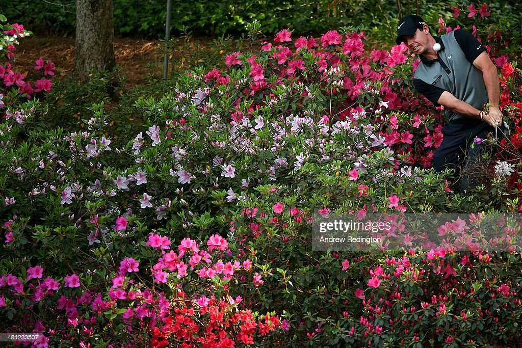 Rory McIlroy of Northern Ireland hits a shot out of the the azaleas bushes behind the 13th green during the second round of the 2014 Masters Tournament at Augusta National Golf Club on April 11, 2014 in Augusta, Georgia.