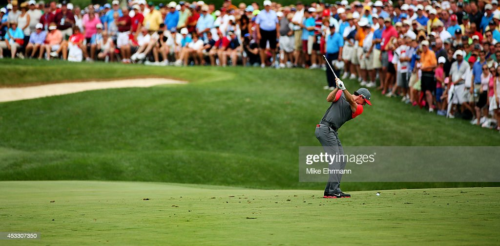 Rory McIlroy of Northern Ireland hits an approach on the first hole during the first round of the 96th PGA Championship at Valhalla Golf Club on August 7, 2014 in Louisville, Kentucky.