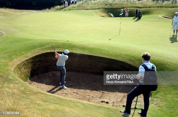 Rory McIlroy of Northern Ireland hits from a bunker ahead of the 142nd Open Championship at Muirfield on July 16 2013 in Gullane Scotland