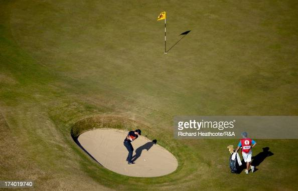 Rory McIlroy of Northern Ireland hits from a bunker on the 10th hole during the second round of the 142nd Open Championship at Muirfield on July 19...