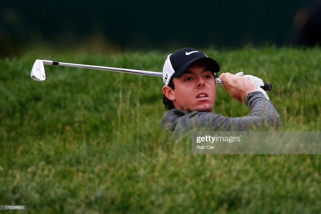 Rory McIlroy of Northern Ireland hits from a bunker on the 15th hole during a continuation of Round One of the 113th US Open at Merion Golf Club on...