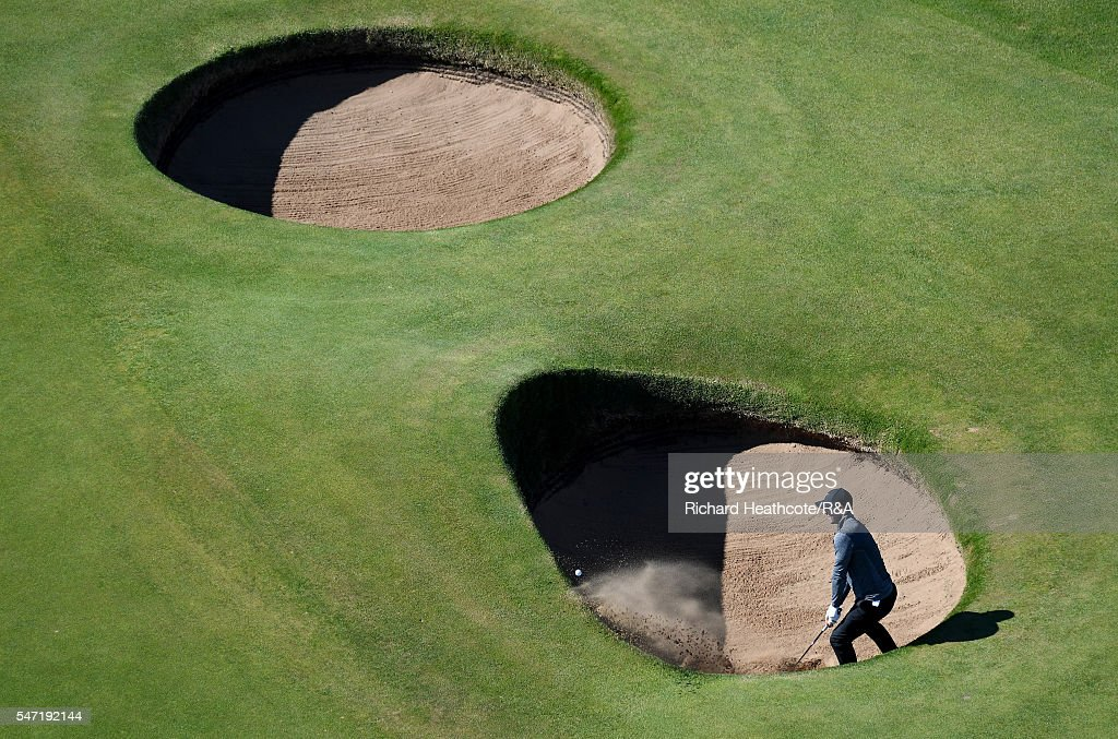 Rory McIlroy of Northern Ireland hits from a bunker on the 2nd hole during the first round on day one of the 145th Open Championship at Royal Troon...