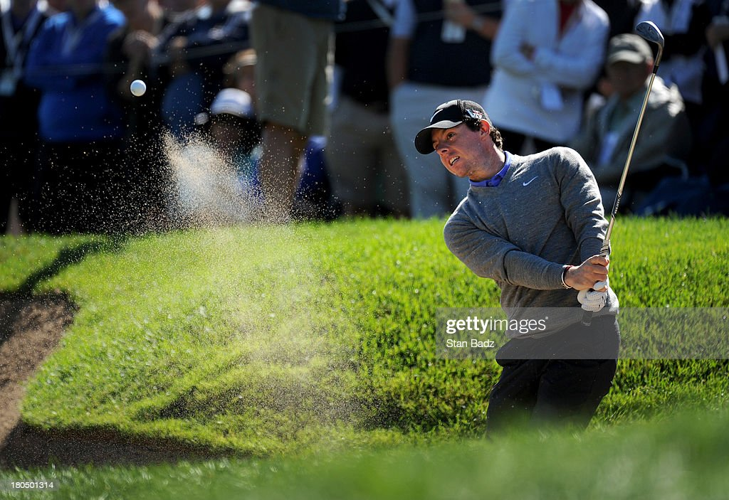 Rory McIlroy of Northern Ireland hits from a bunker on the second hole during the second round of the BMW Championship at Conway Farms Golf Club on September 13, 2013 in Lake Forest, Illinois.