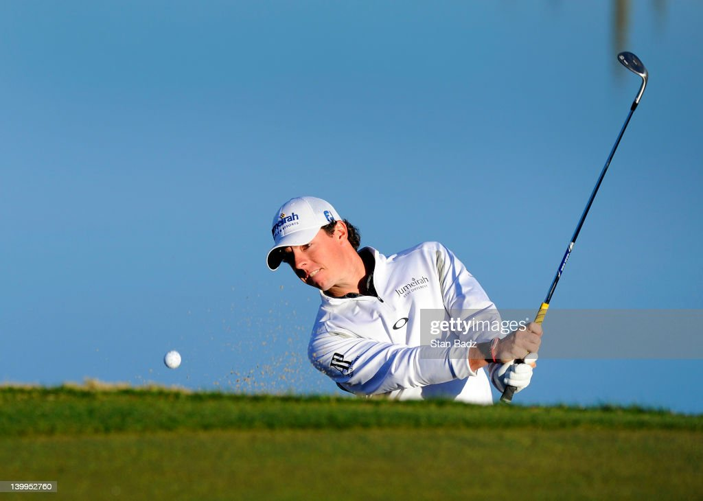 Rory McIlroy of Northern Ireland hits from a greenside bunker on the third hole during the semifinal round of the World Golf ChampionshipsAccenture...