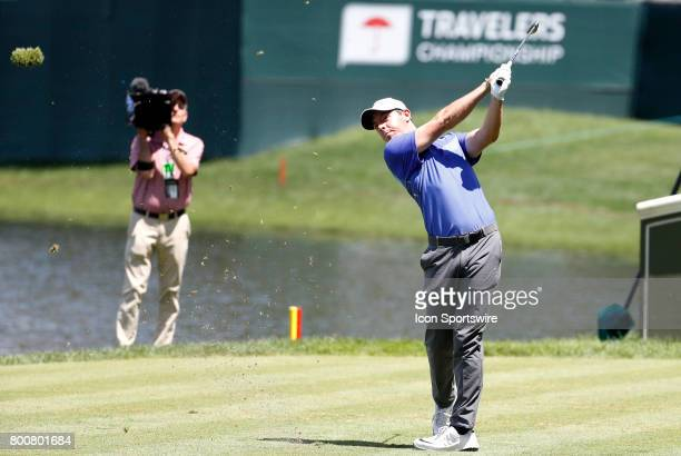 Rory McIlroy of Northern Ireland hits from the 16th tee during the final round of the Travelers Championship on June 25 at TPC River Highlands in...
