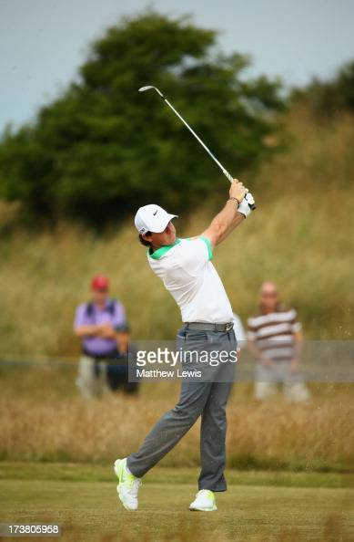 Rory McIlroy of Northern Ireland hits from the 3rd fairway during the first round of the 142nd Open Championship at Muirfield on July 18 2013 in...