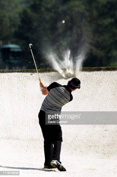 Rory McIlroy of Northern Ireland hits from the bunker on the second hole during the final round of the 2011 Masters Tournament on April 10 2011 in...