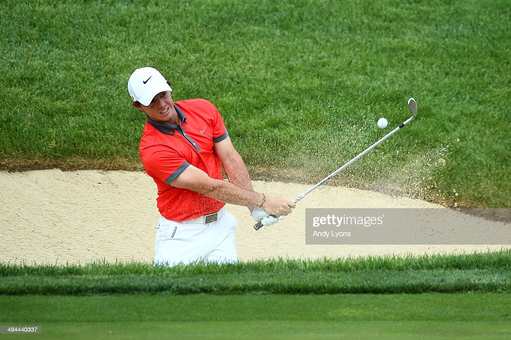 <a gi-track='captionPersonalityLinkClicked' href=/galleries/search?phrase=Rory+McIlroy&family=editorial&specificpeople=783109 ng-click='$event.stopPropagation()'>Rory McIlroy</a> of Northern Ireland hits from the sand on the 17th hole during the first round of the Memorial Tournament presented by Nationwide Insurance at Muirfield Village Golf Club on May 29, 2014 in Dublin, Ohio.