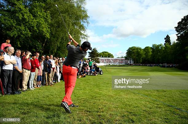 Rory McIlroy of Northern Ireland hits his 2nd shot on the 18th hole during day 2 of the BMW PGA Championship at Wentworth on May 22 2015 in Virginia...