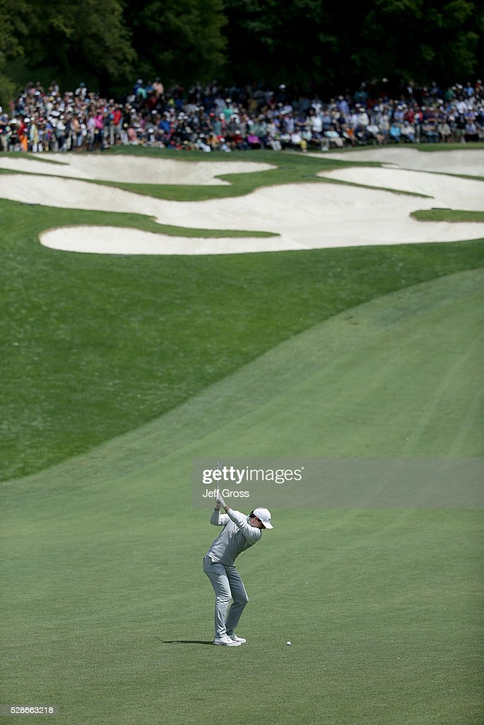 Rory McIlroy of Northern Ireland hits his approach shot on the fifth hole during the second round of the Wells Fargo Championship at Quail Hollow Club on May 6, 2016 in Charlotte, North Carolina.